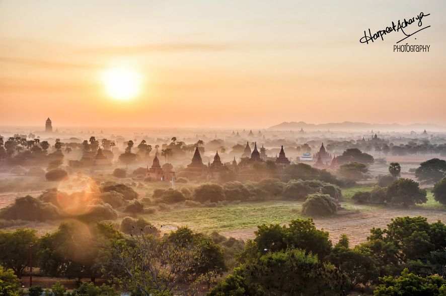 Dawn breaks over the plains, temple spires rising amidst swirling mist…