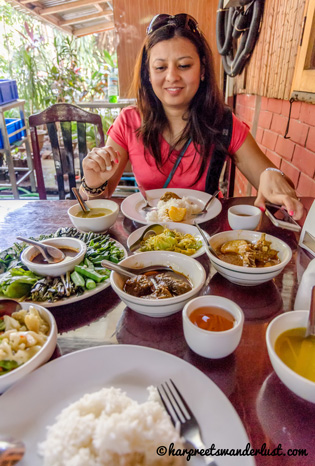 Yours truly – wondering which curry to dig in to at Feel Myanmar