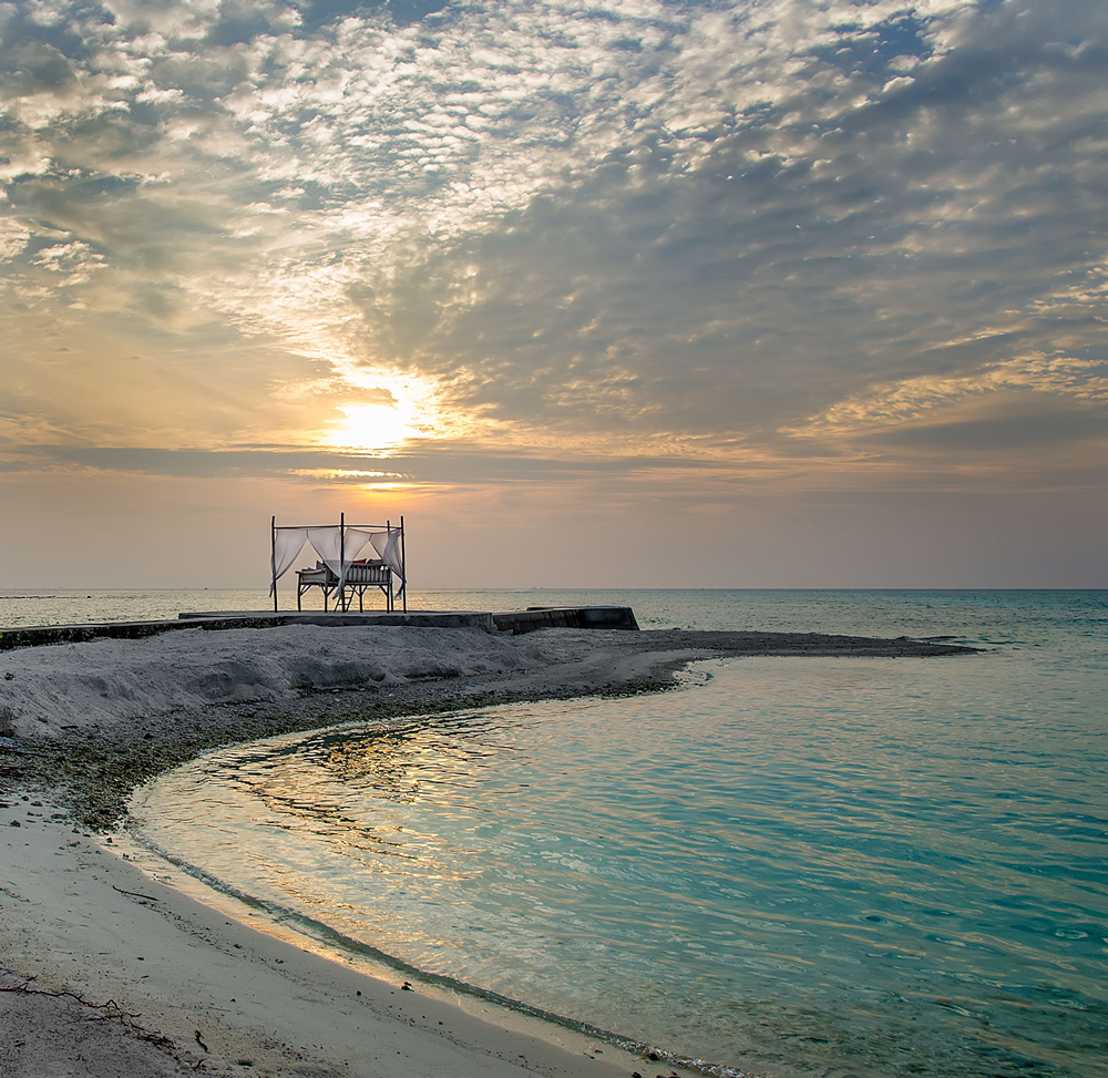 The sun starting to set over the ocean in the Maldives