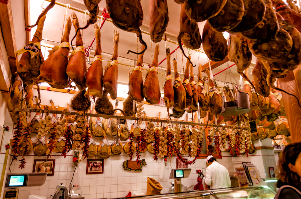 Typical Italian hams hung in Greve
