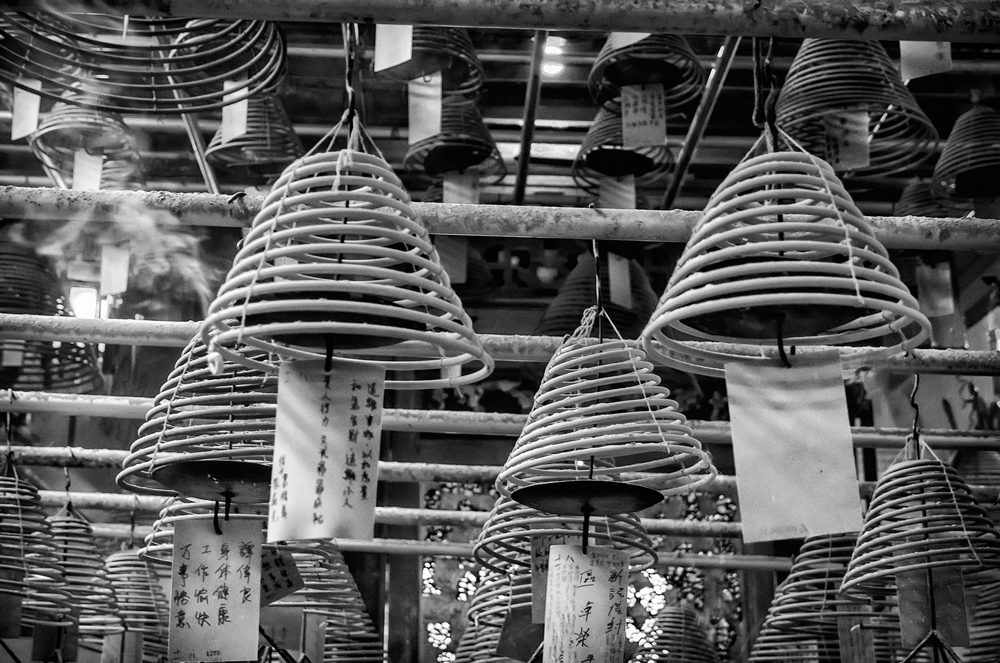 The incense lanterns burning away at Man Mo Temple