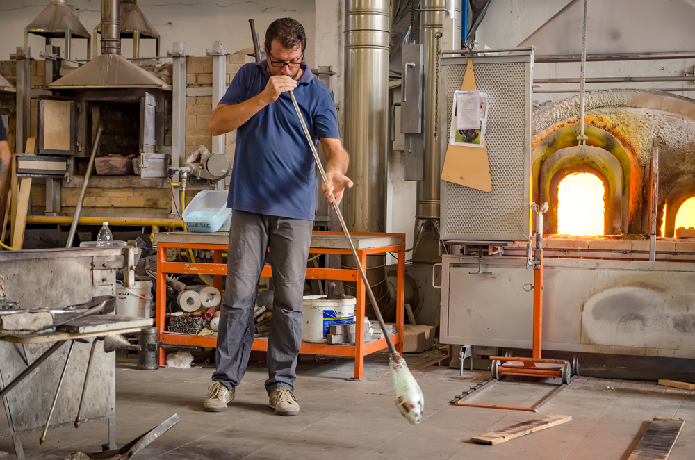Blowing the glass into shape
