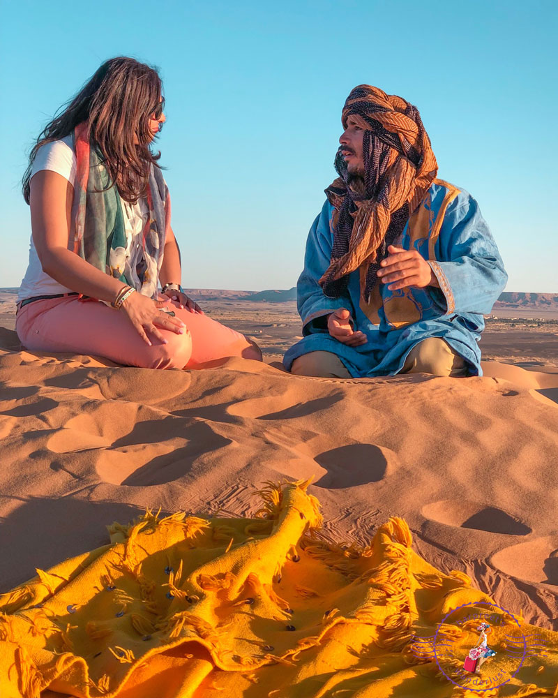 Having a heart to heart with a Berber Nomad In the Sahara